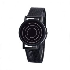 Free Time Watch - Black. has 3 concentric circles that each move with different rotational speeds to indicate the time. each gap in the circle communicates the precise time. The hour, minute and seconds are defined by the outer, middle and inner rings respectively. 33mm diameter. Water-resistant to 100ft. $100.00 #watch #accessories #apparel