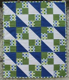 Jaffa quilts:  I'd like to find this pattern, the blue fabrics give the appearance of butterfly's and floating stars.