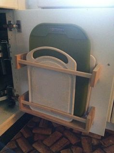 *Cutting board storage from hacked $4 ikea spice racks. One of my better ideas :-) - http://usefulforwomen.info/cutting-board-storage-from-hacked-4-ikea-spice-racks-one-of-my-better-ideas/ #justforwomen #craft #DIY