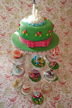 Alice in Wonderland cake with matching cupcakes