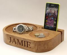 Personalised mobile phone holder with two bits and bobs bowls. Charging cable may be threaded through from the back to charge phone in situ.