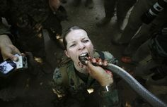 "A U.S. marine drinks the blood of a cobra during a jungle survival exercise with the Thai Navy as part of the ""Cobra Gold 2013"" joint military exercise, at a military base in Chon Buri province, Thailand, on February 20, 2013. About 13,000 soldiers from seven countries, Thailand, U.S., Singapore, Indonesia, Japan, South Korea and Malaysia participated in the 11-day military exercise. (Reuters/Damir Sagolj) #"