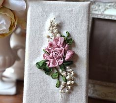 Silk ribbon embroidered roses & blossoms. http://caffeinatedkitten.wix.com/crafts