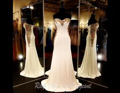 100NC080150378-IVORY/GOLD - This Elegant Gown features Beautiful Intricate Gold Beading and Embellishments on its Sweetheart Neckline plunging down on both sides. Simply Fabulous and ONLY at Rsvp Prom and Pageant... http://rsvppromandpageant.net/collections/long-gowns/products/100nc080150378-ivory-gold