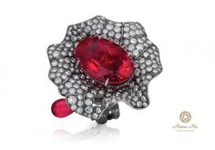 """A 24.13-carat rubellite """"eye"""" surrounded by diamond-set petals. The shank is engraved to resemble the lotus stem. Natural fancy vivid yellow, gray and white diamonds, natural Burmese rubies, Colombian emeralds, demantoid garnets, tsavorites, faint to intense pink sapphires set in gray titanium. Photo courtesy of Anna Hu Haute Joaillerie."""