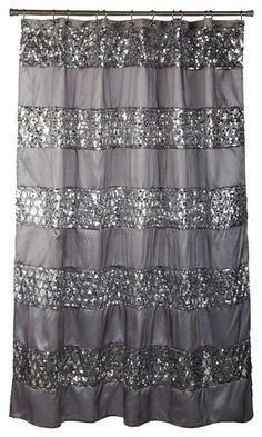 I have this shower curtain in my bathroom. Really makes it look elegant especially since everything else is either black, gray, or white. I also have bright yellow accents. It's perf