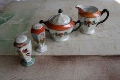 Vintage Colorful Lot Of Iridescent German Creamer and Sugar With 2 Similar Japan Shakers Luster