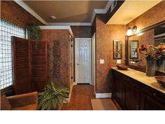 Warm, Relaxing and Wish I Had Room for a Fireplace, Small Master Bath turned into a relaxing comfortable space - taller vanity from a retrofitted buffet copper sinks etc.....exquisite.  , Bathrooms Design