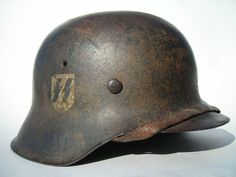 """World War II, German M-1933 Stahlhelm with the Waffen-SS emblem, indicating the armed wing of the Nazi Party's Schutzstaffel (SS, """"Protective Squadron""""),"""