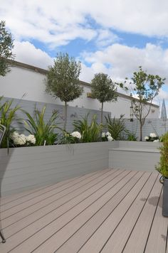 composite decking hardwood grey privacy screen trellis hardwood planter boxes modern planting tower bridge fulham chelsea london garden design