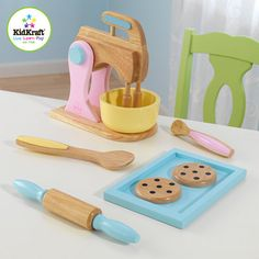 Pastel Baking Set...pretend cooking is such a great investment....my 5 year old BOY still plays with his cooking sets:)