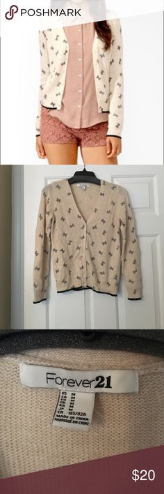 Pink Rabbit Hair Cardigan with Black Bow Print This adorable F21 Cardigan is a blush pink color with black bows printed on it. It is 20% Rabbit hair. So warm and perfect for winter! I've only worn it a few times and it is in excellent condition! Forever 21 Sweaters Cardigans