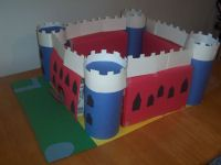 This is a castle craft that we did a few years ago. It was a huge hit. It utilized a few cereal boxes, four oatmeal containers and a lot of colorful paper. It was big enough for my son to sit in and was a great play area for many of his toy figures. We kept it for several months and have considered building it again.