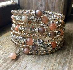 Shimmering Sunstone Memory Wire Bracelet With Silver Flower Spacers