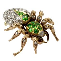 A Demantoid Garnet and Diamond Spider Brooch. | From a unique collection of vintage brooches at http://www.1stdibs.com/jewelry/brooches/brooches/