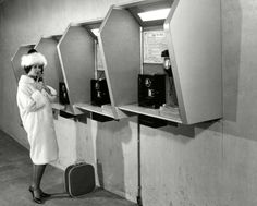 [Woman using a public telephone at Spencer Street Station] [picture] , State Library of Victoria