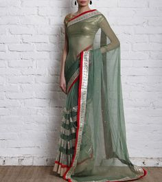This pretty Moss green saree by PRITI SAHNI now available on Indianroots.in (an NDTV Venture)  Click to buy :  http://www.indianroots.in/brands/m-q/pret-i-by-priti-sahni/moss-green-chiffon-and-net-saree-with-mirror-work