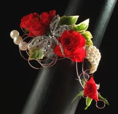 Lovely rhinestone and pearl wrist corsage with dragonfly accent with red roses. Prom Corsage And Boutonniere, Wedding Corsages, Wrist Corsage, Boutonnieres, Homecoming Flowers, Prom Flowers, Bridal Flowers, Silk Flowers, Wedding Crafts