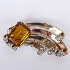 """<b>LARGE Trifari Alfred Philippe fur clip; two tone gold Deco swirl spray with emerald cut citrine color stone and pave rhinestones.</b> No missing stones. No repairs. Light wear to gold wash. Center stone in very good condition. H 4 1/4"""""""