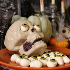 Creepy Mozzarella Eyeballs!  They say you should watch what you eat, but this treat watches you. Serve them up for a tasty appetizer or use them for a creepy pizza topper. #appetizer #halloween food ideas #snacks