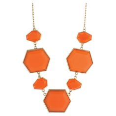 Gold-hued metal necklace with geometric faceted orange beads.   Product: NecklaceConstruction Material: Metal an...