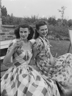 Two beautifully attired gals (with terrific hair) relaxing in the garden found photo young women in sundresses plaid print day casual 40s 50s vintage style fashion