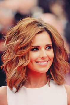 Shoulder length - layered and wavy with lots of volume.