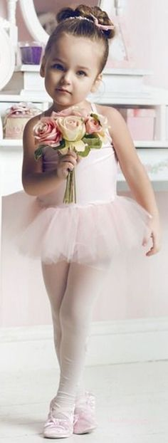 """Chloe hands 3 year old Ailynn her flowers. """"Who did a good recital?"""" Chloe asks tickling Ailynn. """"Me!"""" Ailynn laughs. """"That's right!"""" Chloe says. """"You truly were the best dancer up there!"""" Mikel says. Ailynn blushes. """"Thanks daddy."""" Ailynn blushes."""