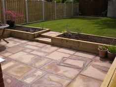 kleiner garten Landscaping in Chesterfield includes Indian stone patio, hit n miss fencing, turf lawn and sleeper beds Back Garden Design, Backyard Garden Design, Backyard Landscaping, Backyard Patio, Stone Backyard, Patio Steps, Garden Steps, Lawn And Garden, Back Gardens