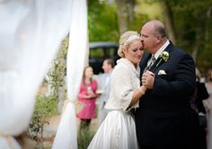 A moment between the bride and her father while they dance together. Photo by Dana Grace Photography