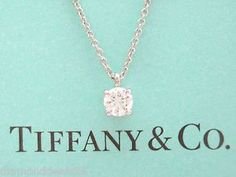 <With love> from Burberry for Christmas Return to Tiffany? mini double heart tag pendant in silver with enamel finish.