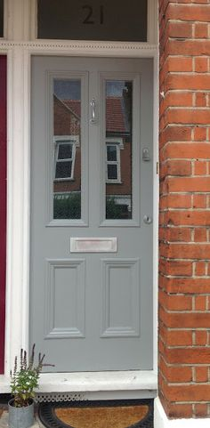 Front door painted Farrow & Ball Manor House Grey.  Considering it exterior walls in the yard
