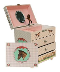 A sweet gift for collecting treasures, this charming music box is a classic treat for any special girl. Featuring a twirling ballerina that plays ''Beautiful Dreamer,'' its trio of drawers is sure to preserve sweet memories in darling style.6.25'' W x 7'' H x 4.5'' DFiberboardImported