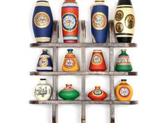 12 Terracotta Warli Handpainted Vases With Antique Wooden Frame Wall Hanging