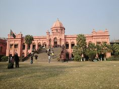 Ahsan Manzil, the pink palace. his stately monument was originally built in 1872 by Nawab Abdul Ghani, as a palace on the site of an old French Factory and it was named after his son Nawab Ahsanullah Bahadur. It was heavily damaged by the devastating tornado of 1888 but was later reconstructed completely with substantial alterations to its original appearance.