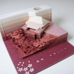A Paper Memo Pad That Excavates Objects as It Gets Used