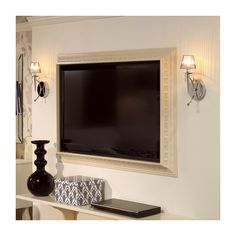 Make a picture frame for flat-screen TV  - just use crown molding!! Great idea!!