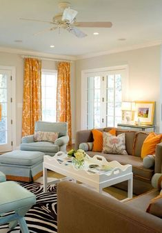 Take a look at this brown living room with alcove shelves from Style at Home for inspiration. Living Room Colors, Living Room Paint, Home Living Room, Living Room Designs, Living Room Decor, Blue And Orange Living Room, Orange Rooms, Orange Curtains, Furniture