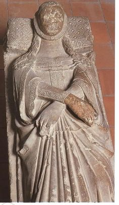 Tomb of Queen Elisende, 1322-1327, Monestir de Pedralbes, Barcelona. Note the loose hair.