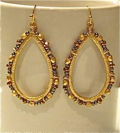 Exotic Tear Drop Earrings with Gold, Bronze and Dark Silver coloured Beads.These dangling earrings are made with metallic and beads and hold on fish-hook wires. Teardrop Earrings, Dangle Earrings, Silver Color, Exotic, Bronze, Beads, Dark, Metal, Gold