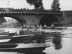 A St Neots Rowing 'eight' passing under the old St Neots town river bridge c1950.
