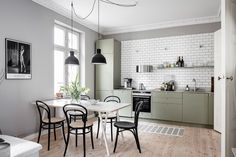 I love the contrast here of the minimally decorated grey interior with the olive green kitchen cabinets combined with the metro tiles on the wall. Kitchen Furniture, Kitchen Interior, Interior Design Living Room, Kitchen Decor, Kitchen Design, Green Kitchen Cabinets, Kitchen Cabinetry, Kitchen Colors, Olive Green Kitchen