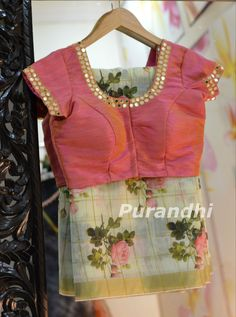Best 12 Beautiful olive green color floral print saree and pink color designer blouse with hand embroidery mirror work on neck line. Saree Blouse Neck Designs, Fancy Blouse Designs, Blouse Patterns, Mirror Work Blouse Design, Mirror Work Saree Blouse, Aari Work Blouse, Floral Print Sarees, Floral Blouse, Stylish Blouse Design