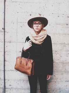 | black skinnies. black sweater. cream scarf. - outfit idea - minimal wardrobe - wear black
