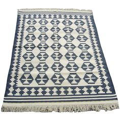 Aside from the fact that Overstock.com's Indo Kilim Ivory/ Navy ...