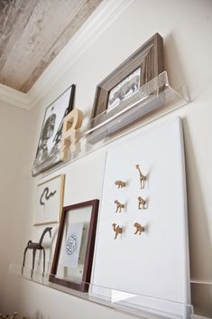 Spotted: Acrylic Wall Shelf. Clear modern ledge with upturned edges plays…