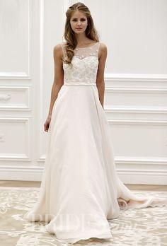 An A-line @annebargebride wedding dress with an embellished illusion neckline | Brides.com