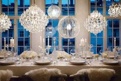 Winter Wedding Table Set Up. Chandeliers Hang like Snowflakes.