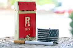 I like the contrast between the red and blue in the cigarettes and lighter. The brightness in the background makes the cigarettes and lighter the first thing you look at. The wicker gives the photo somewhat of a texture. - Lindsay Jones