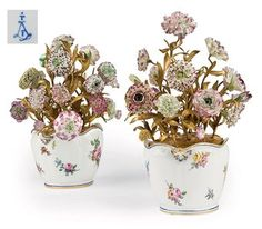 TWO SEVRES GLASS-COOLERS MOUNTED WITH ORMOLU AND PORCELAIN FLOWERS (SEAU A VERRE ECHANCRE)